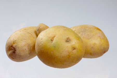 comestible: three potatoes Stock Photo