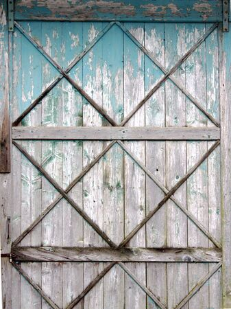 a barn door with faded paint photo