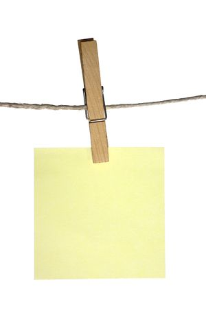 sticky note hanging on a peg from a line photo