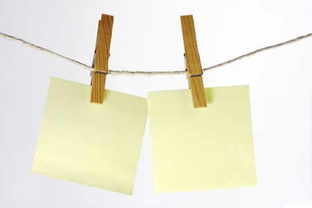sticky note hanging on a peg from a line