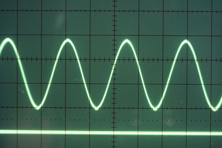 a sine wave on the screen of an old oscilloscope photo