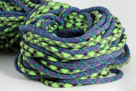 rapelling: purple and green climbing rope