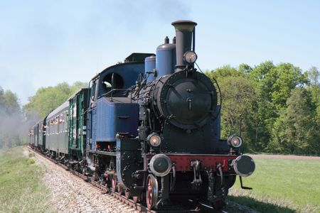 old steam engine powered train approaching Stock Photo - 3061861