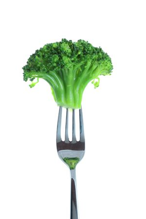 broccoli on a fork over white background photo