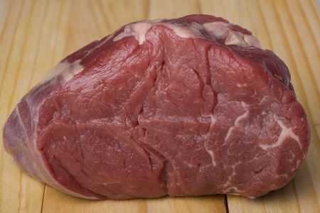 piece of raw meat on a wooden chopping board Stock Photo - 3331536