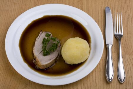 bavarian roast pork dish with potato dumpling photo