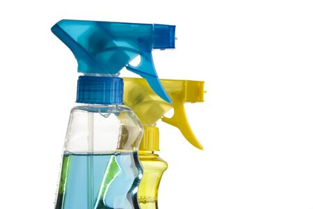 disinfect: blue and yellow trigger spray bottles