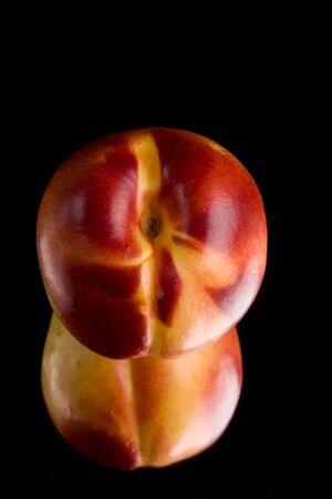 single nectarine on a mirror Stock Photo - 3409691