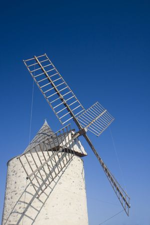 an old windmill on a sunny day in southern france Stock Photo