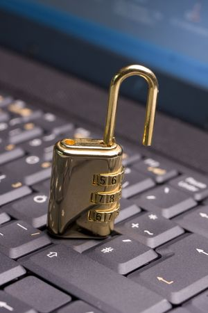 a golden padlock on a black notebook keyboard