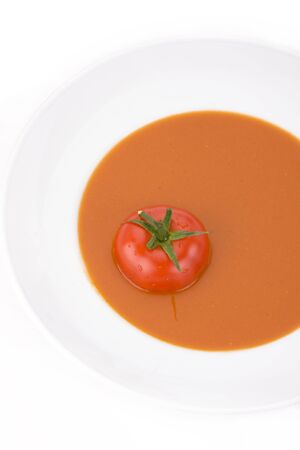 home made tomato soup in a white bowl photo