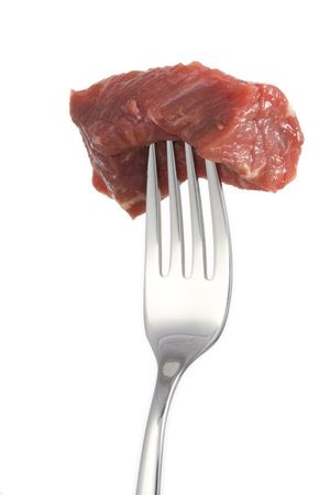 piece of meat on a fork isolated on white background Stock Photo