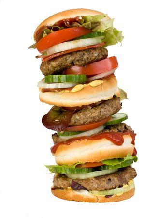 a home made quadruple hamburger isolated on white background