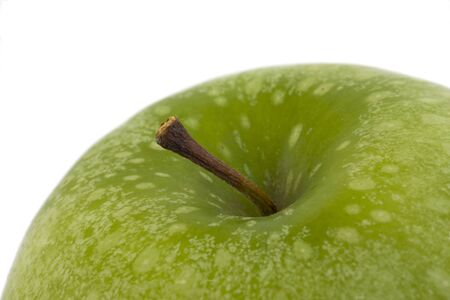 granny smith apple: detail of a granny smith  apple isolated on white background