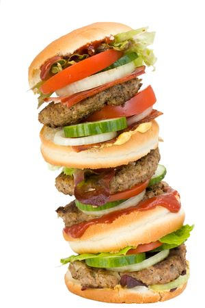 quadruple: a home made quadruple hamburger isolated on white background