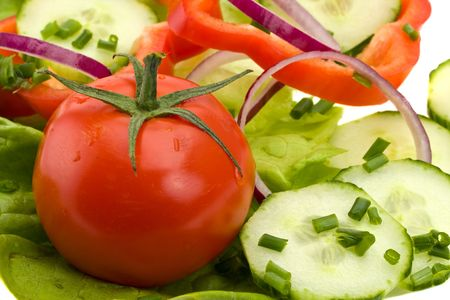 closeup of a tomato on a bed of salad Stock Photo - 3832502