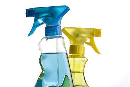 blue and yellow trigger spray bottles photo