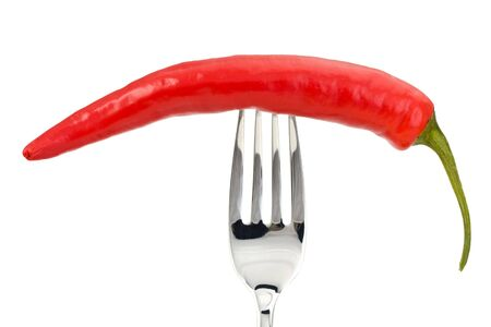 red pepper on a fork isolated on a white background