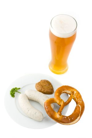 bavarian white sausage, wheat beer and pretzel
