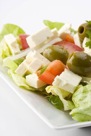 detail of a greek salad on a plate photo
