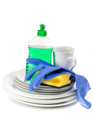 dinnerware and cleaning utensils isolated on white background photo