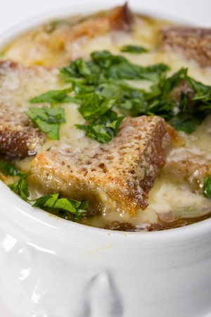 onion soup scalloped with cheese in a soup pot photo