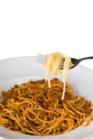 bolognaise: fork over a plate with spaghetti bolognaise