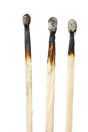 three burned matches isolated on white background photo