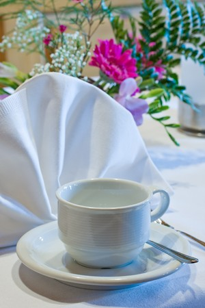 banquette: empty coffee cup on a decorated table
