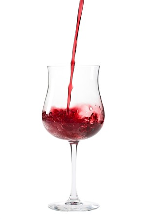 red wine splashing in a glass photo