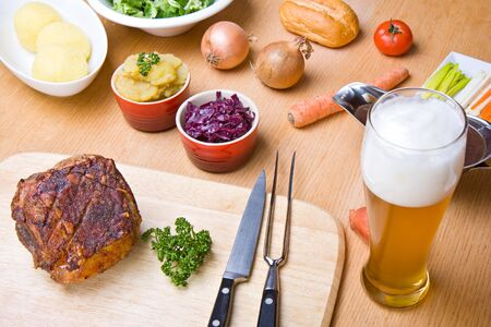 traditional bavarian roast pork with beer sauce and dumplings photo