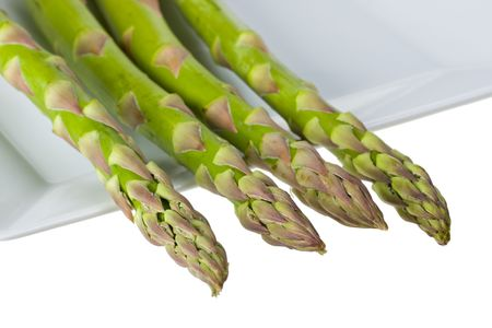 detail of fresh green asparagus isolated on white background photo