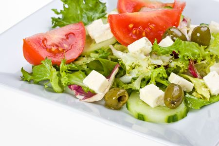 detail of a greek salad on a white plate photo