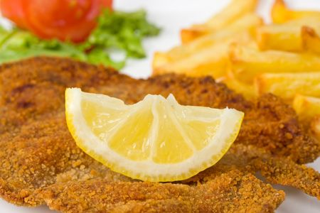 detail of a viennese schnitzel on a plate 免版税图像