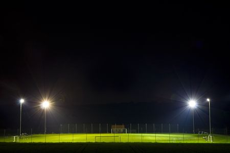 empty soccer pitch illuminated at night
