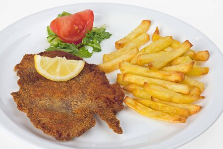 viennese: detail of a viennese schnitzel on a plate Stock Photo