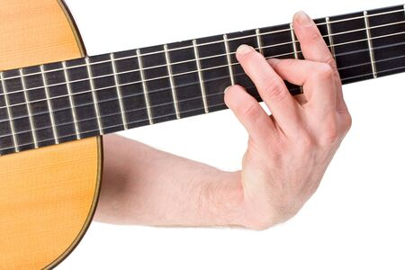 male hand holding a chord on a classsical guitar Stock Photo - 4810311