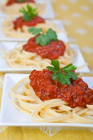 spaghetti with tomato sauce and parsley photo