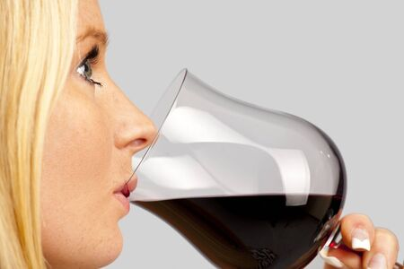 pretty young woman enjoying a glass of red wine photo