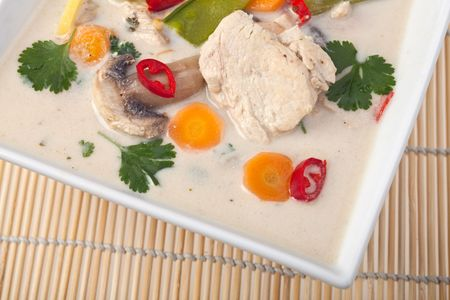 thai tom kha gai soup in a bowl