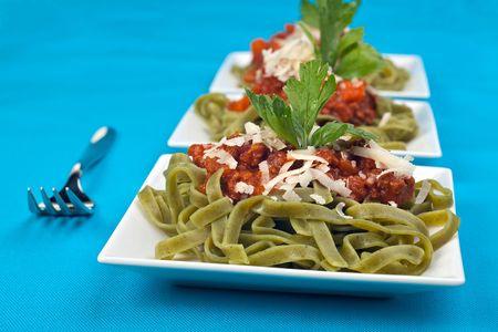 bolognaise: tagliatelle with sauce bolognaise in white plates