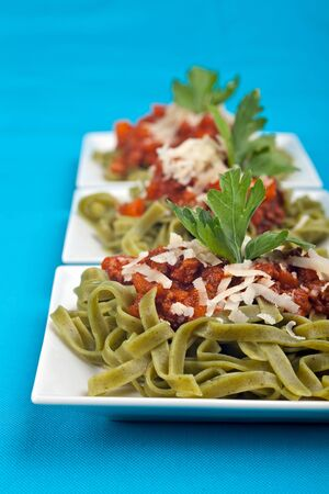 tagliatelle with sauce bolognaise in white plates Stock Photo - 5033307