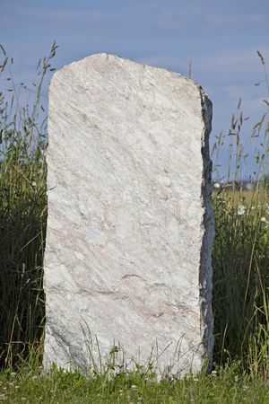single empty granite gravestone on a grass meadow Stock Photo