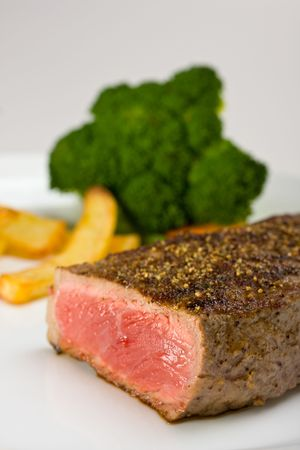grilled steak on a plate with fries Stock Photo