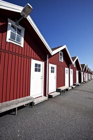 red swedish boat houses on a sunny day Stock Photo - 5454594
