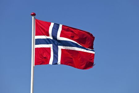 norwegian flag in the wind outdoors Stock Photo