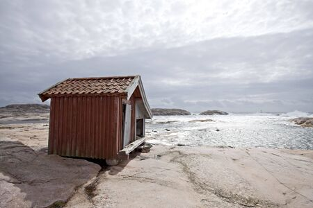 hut on a beach on a windy day photo