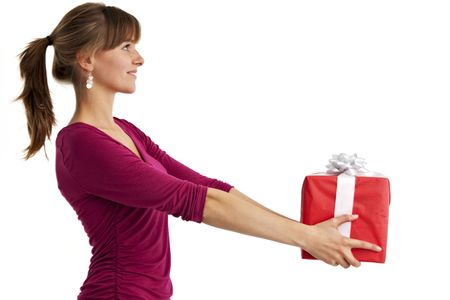 pretty young woman holding a present isolated on white Stock Photo - 5729918