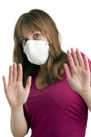protective wear: scared young woman wearing a protective mask to protect her from swine flu