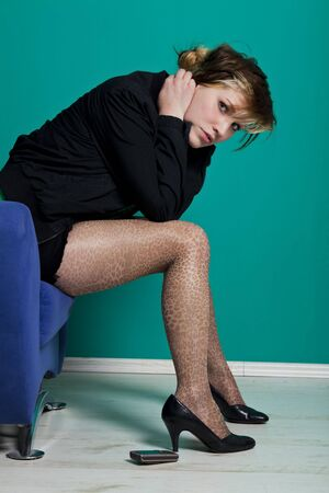 young woman with leopard tights in despair photo